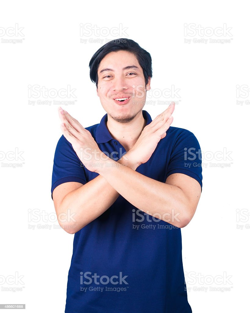 Asian Young man pumped up, making X sign shape stock photo