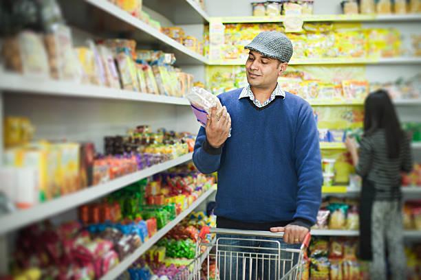 Asian young man shopping at supermarket. stock photo