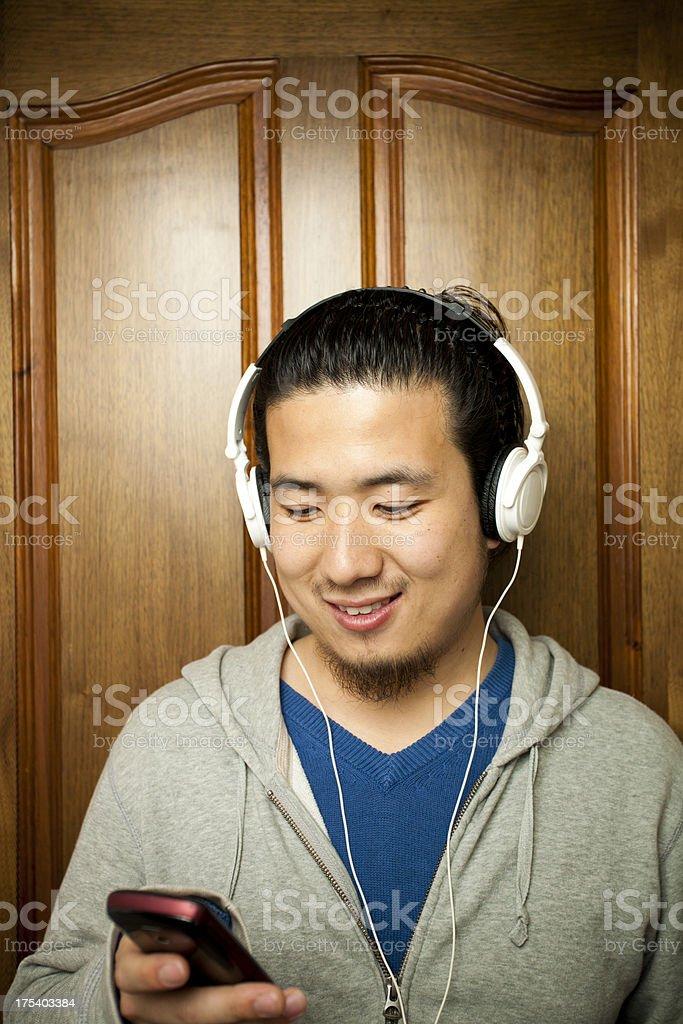 Asian young man texting royalty-free stock photo