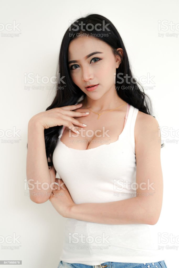 Asian young sexy lady black long hair in white vest stock photo