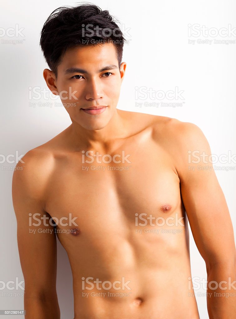 asian young sport man with perfect fitness body stock photo