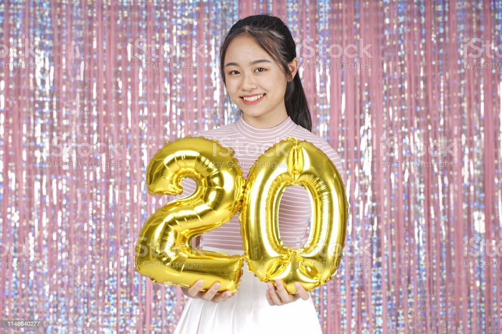 Asian young teenager pretty cheerful beautiful girl with party gold...