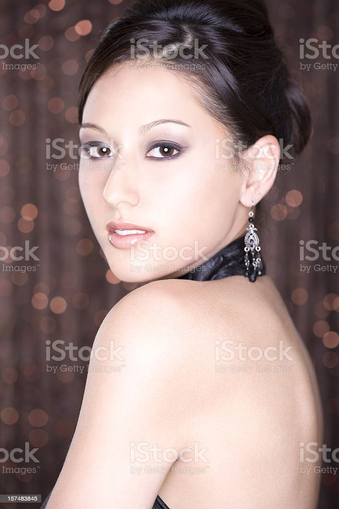 Asian Young Woman Beauty Portrait in Evening Gown and Updo stock photo