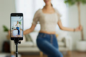 istock Asian young woman created her dancing video by smartphone camera. To share video to social media application. 1303246836