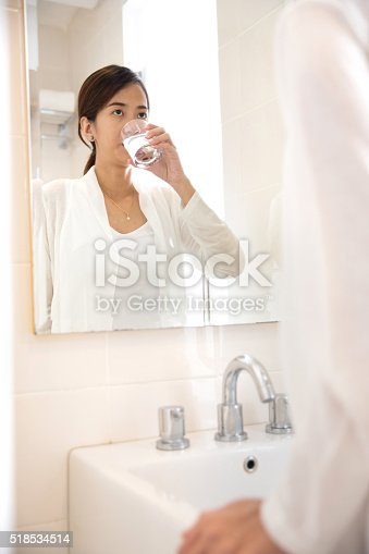 istock Asian young woman gargle on her mouth after tooth brushing 518534514