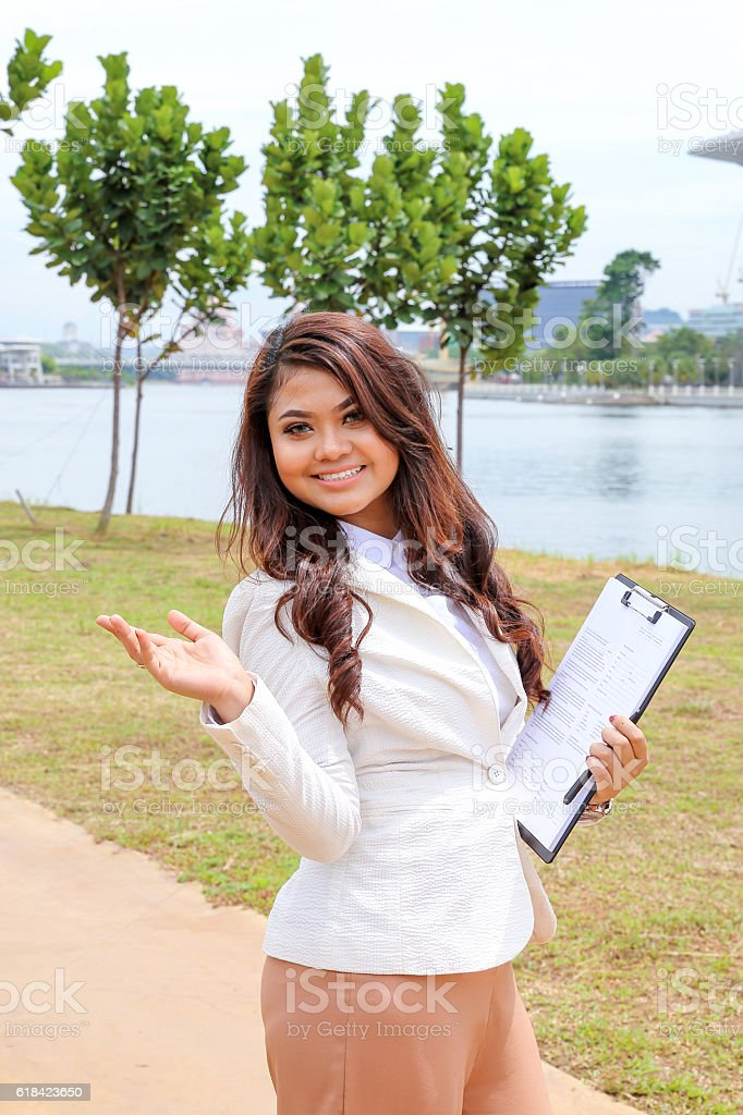 Asian young woman holding clapboard file with hand gesture  smil stock photo