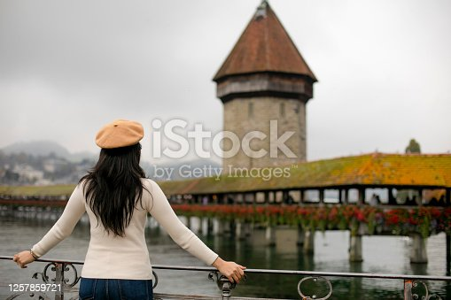 asian young woman traveling and looking the Lucerne city view during autumn season