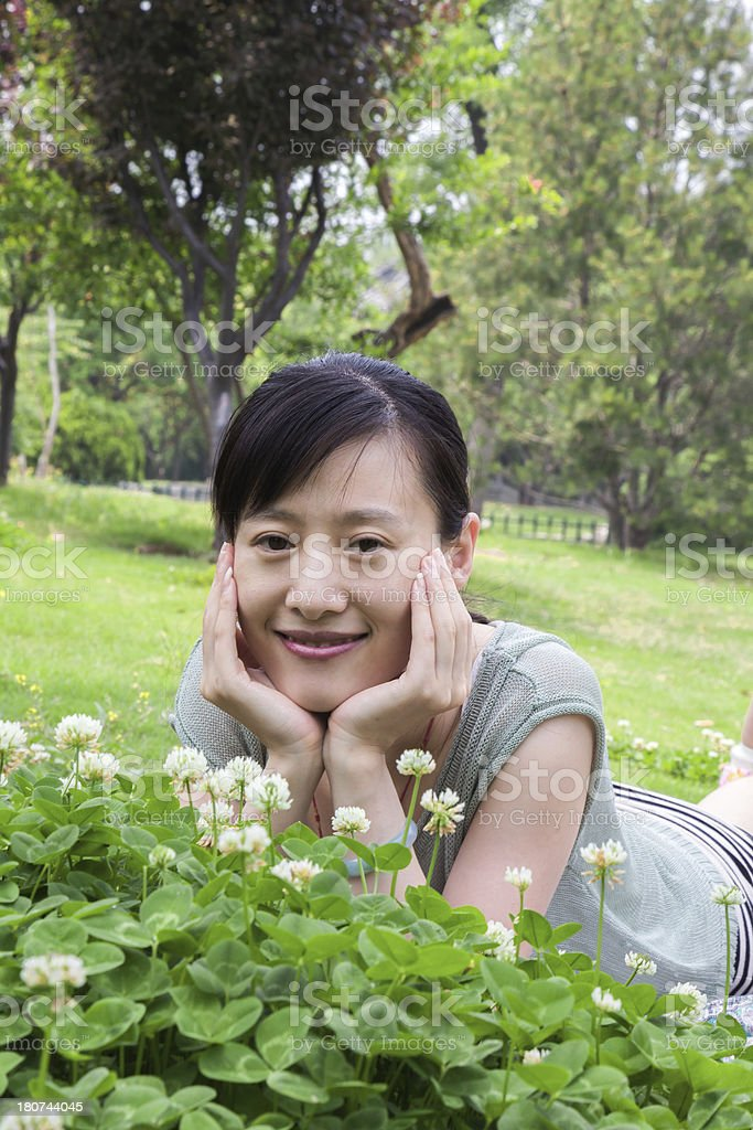 asian young woman lying on grass in nature royalty-free stock photo