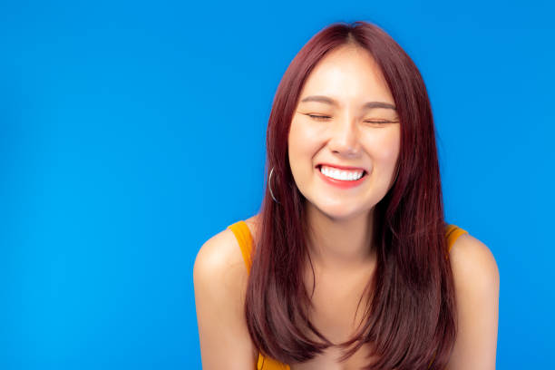 Asian young woman showing perfect whitening teeth. Portrait beautiful young Asia female with perfect smile Happy girl smiling with happiness. Attractive woman had nice smile, get confident when smile stock photo