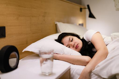 asian young woman sleeping at home