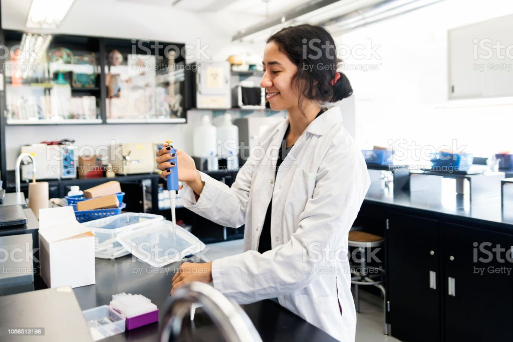 Asian young woman student in college science laboratory. stock photo