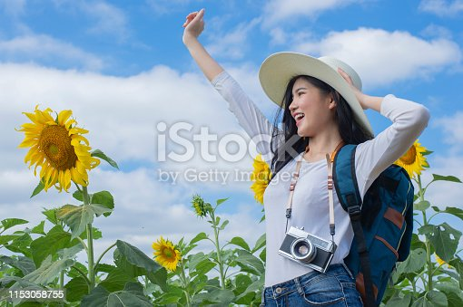 istock Asian young woman visit sunflower field - Image 1153058755