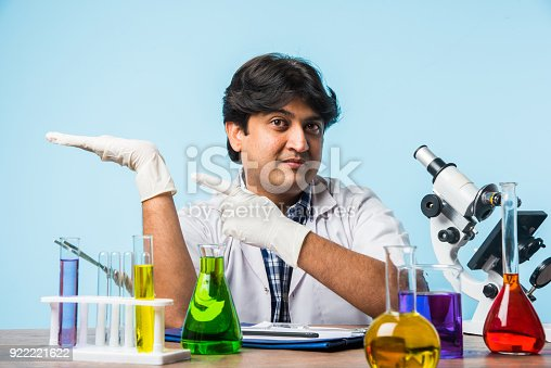 Asianindian Male Scientist Or Doctor Or Science Student Experimenting With Microscope And Chemicals Laptop And Smartphone In A Lab Stock Photo More