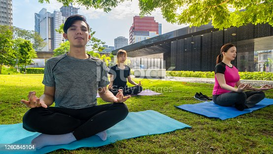 istock Asians doing yoga outdoor. Healthcare and body-care concept 1260845104