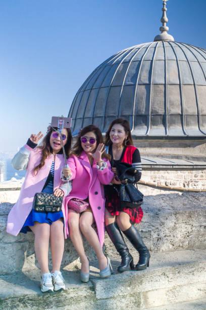 Asians girls doing selfie stock photo