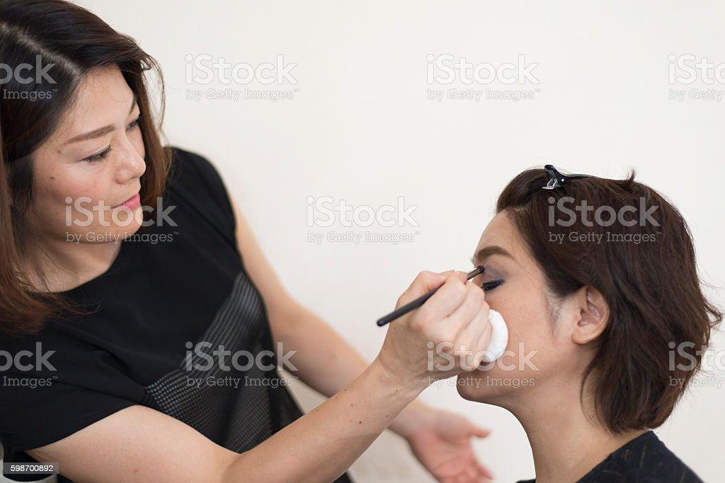 Asian's make-up artist photo libre de droits