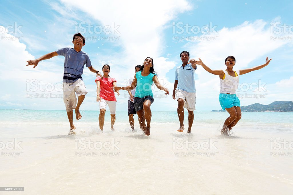 Asians people running out of the sea. royalty-free stock photo