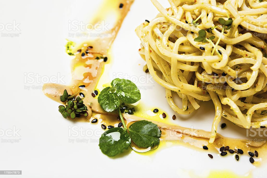 Asian-style noodles with sweet-chili sesame sauce and micro herbs royalty-free stock photo