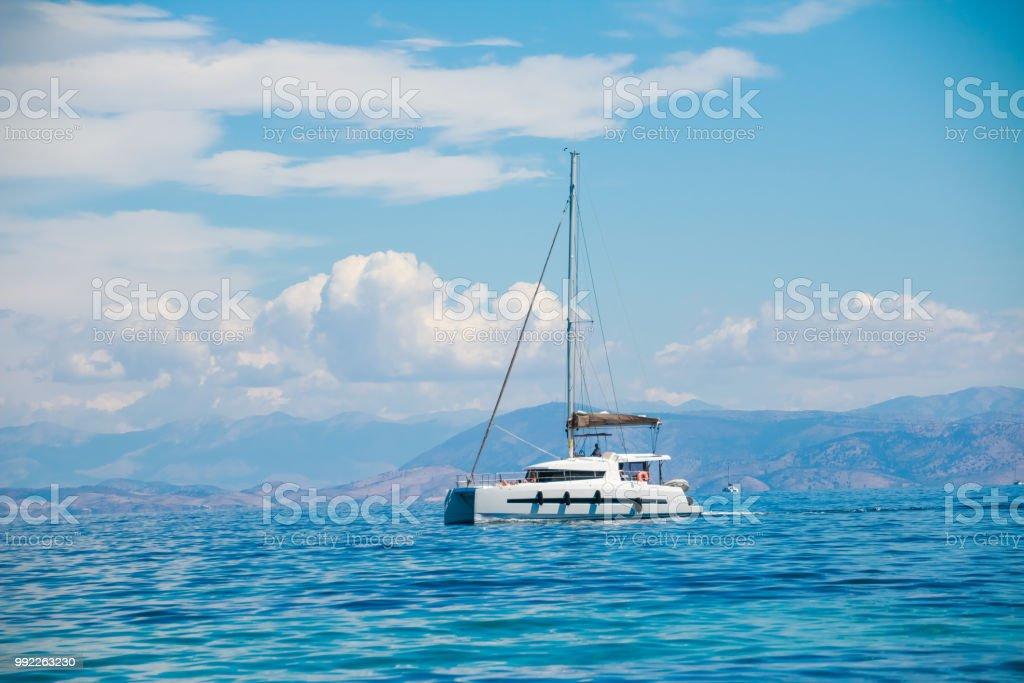A single catamaran in the open sea. Boat vacation concept