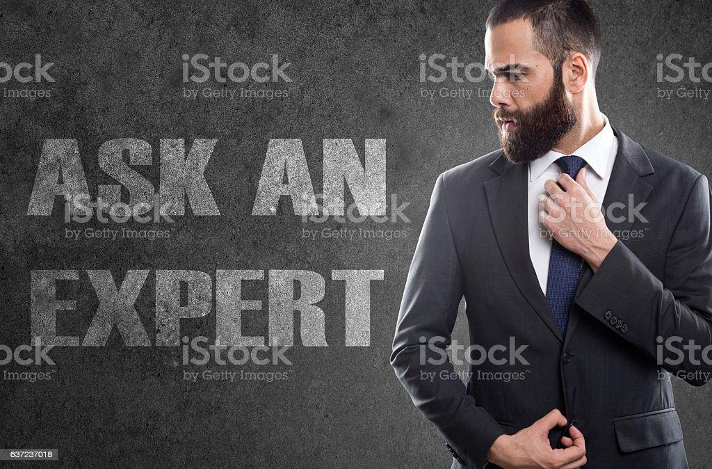 Ask an expert written on blackboard stock photo