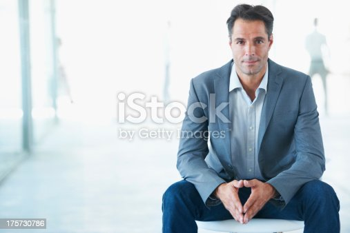 A mature businessman looking at the camera