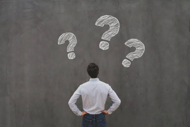 ask questions, interrogation marks, why what where when how who stock photo
