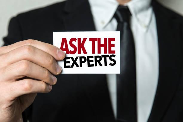 Consulte los expertos - foto de stock