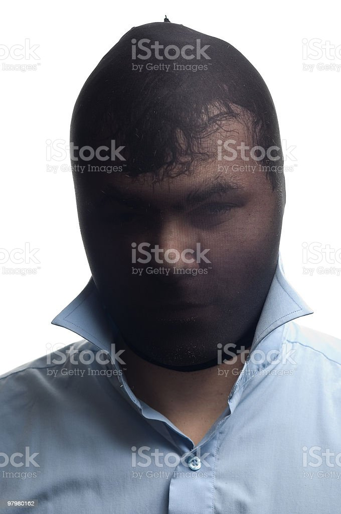 Мasked man in a blue shirt royalty-free stock photo