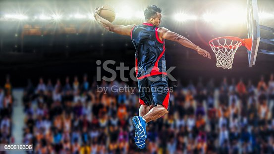 istock asketball Player scoring an athletic slam dunk shoot 650616306