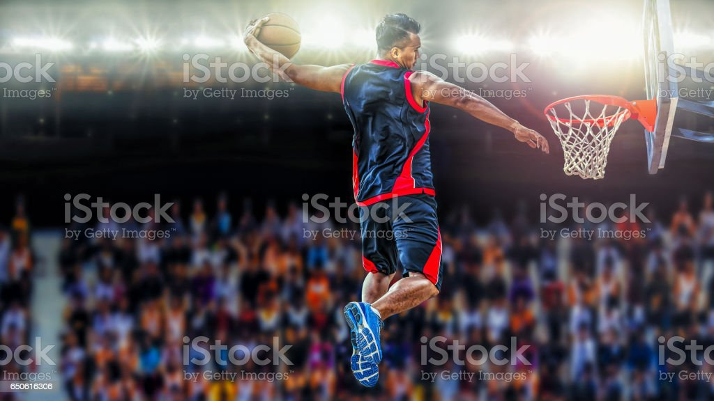 asketball Player scoring an athletic slam dunk shoot stock photo