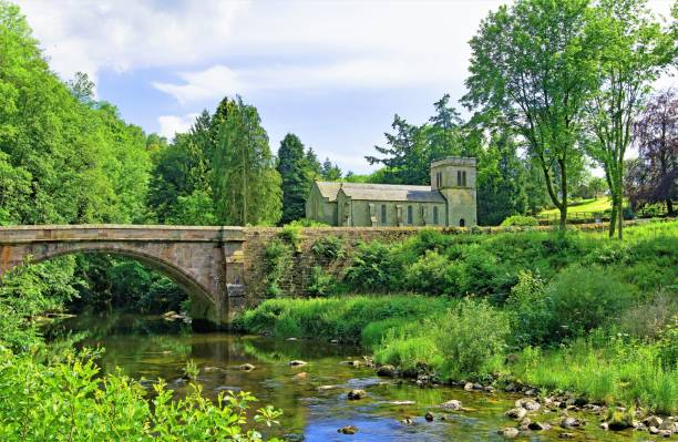 Askham Bridge and St Peter's Church 2, Askham, Penrith, Cumbria, England. A beautiful and picturesque English countryside village scene, in Penrith, Cumbria. cumbria stock pictures, royalty-free photos & images