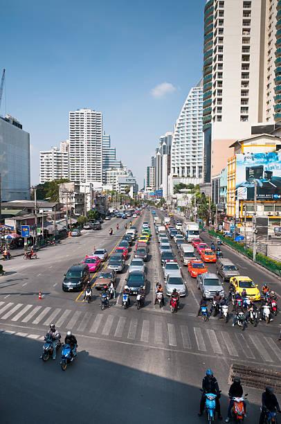 asoke junction in bangkok - motorbike, umbrella stock photos and pictures