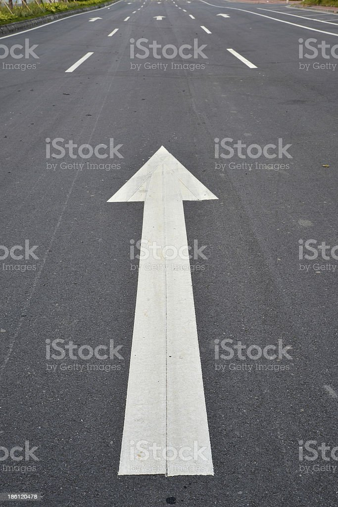 Aspalt road with arrow forward royalty-free stock photo