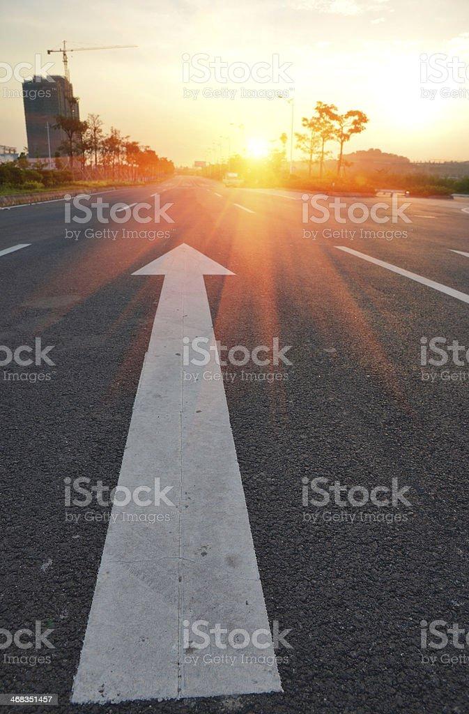 Aspalt road with arrow forward royalty-free stock photo