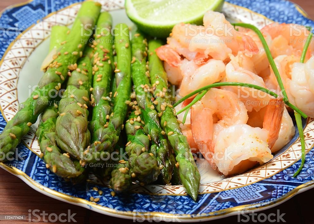 Asparagus and shrimps  fried with garlic, ginger, sesame royalty-free stock photo