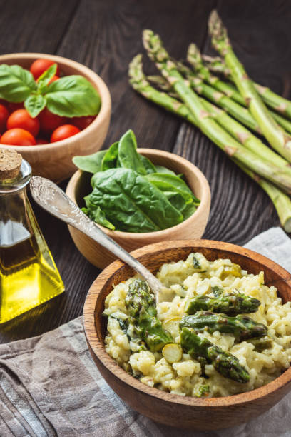 Asparagus and spinach risotto , italian cuisine. stock photo