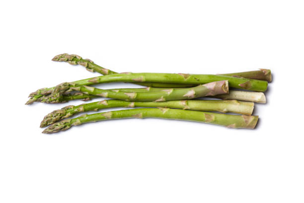 asparagus on white - asparagus stock pictures, royalty-free photos & images