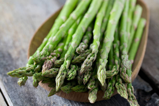 asparagus on wooden surface stock photo