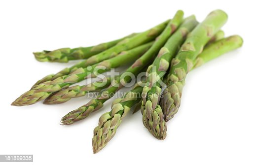 Asparagus stalks on white background.