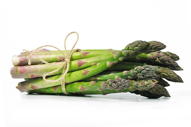 Asparagus Asparagus isolated on white bundle stock pictures, royalty-free photos & images