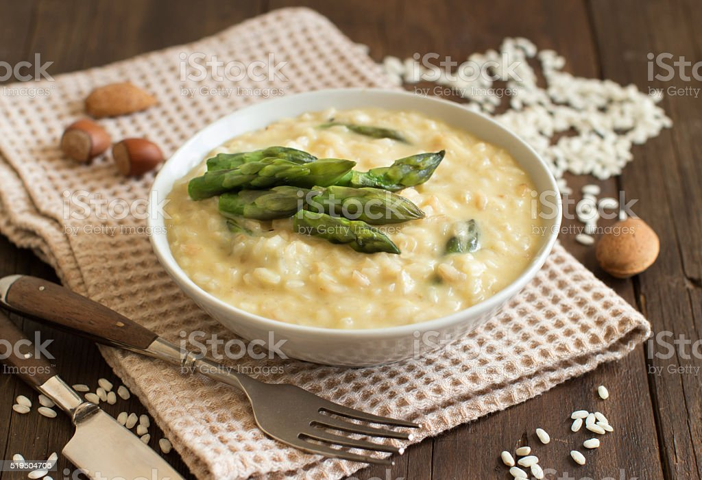 Asparagus risotto with parmesan and taleggio stock photo