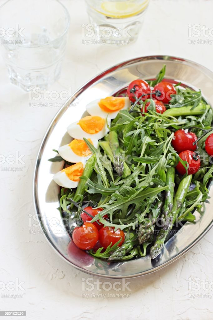Asparagus salad with arugula, cherry tomatoes and eggs. royalty-free stock photo