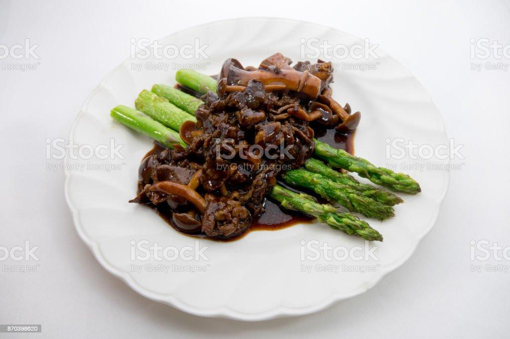 Asparagus saute with  Brown mushroom sauce stock photo
