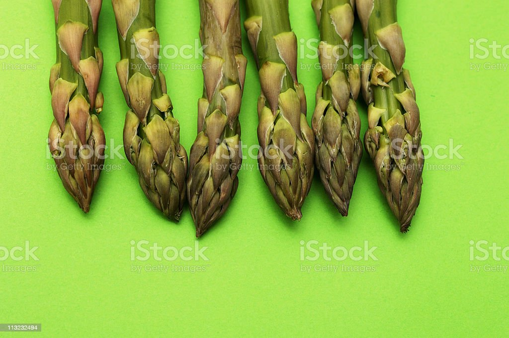 asparagus spears isolated against green royalty-free stock photo