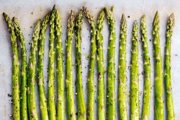 Asparagus Spears on Oven Tray ready for Roasting stock photo