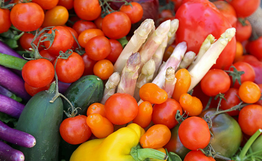 istock asparagus tomatoes and more vegetables for sale at market 1049273634