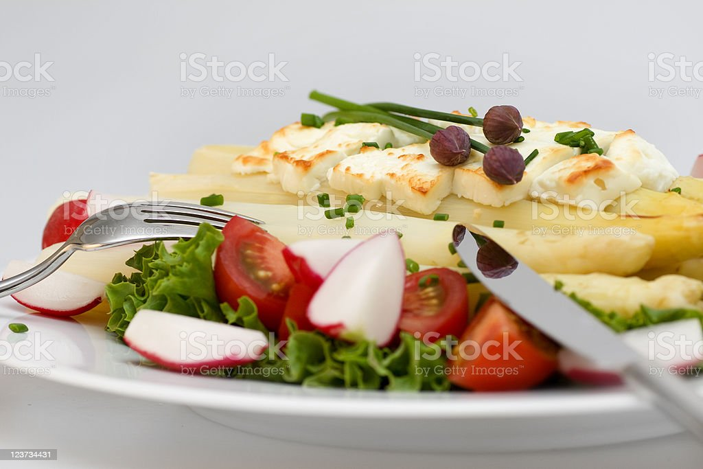 Asparagus with feta cheese and silverware royalty-free stock photo
