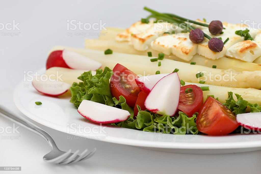 Asparagus with feta cheese royalty-free stock photo