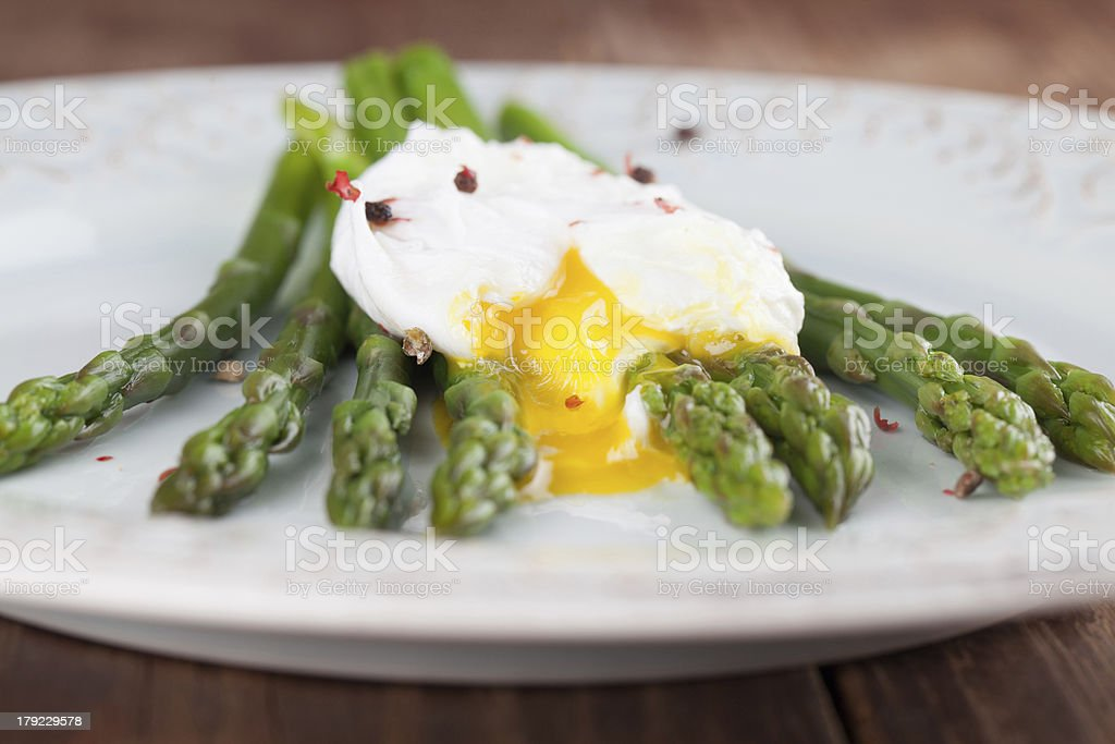 Asparagus with poached egg stock photo