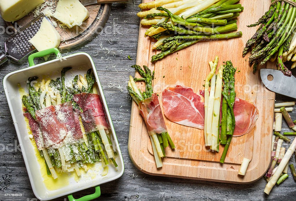 Asparagus wrapped in Parma ham with cheese royalty-free stock photo